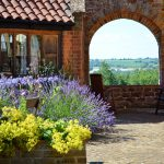The archway in courtyard looking out to the Cotswold hills