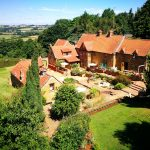 Heath Farm Holiday Cottages Courtyard with views of rolling Cotswold Hills